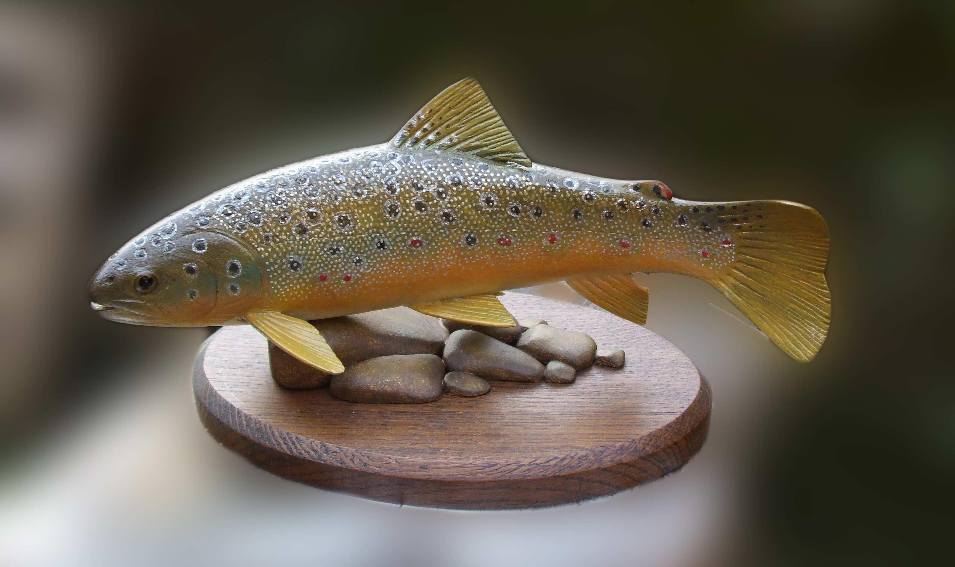 Mantle with brookie trout carved in black walnut ogg furniture